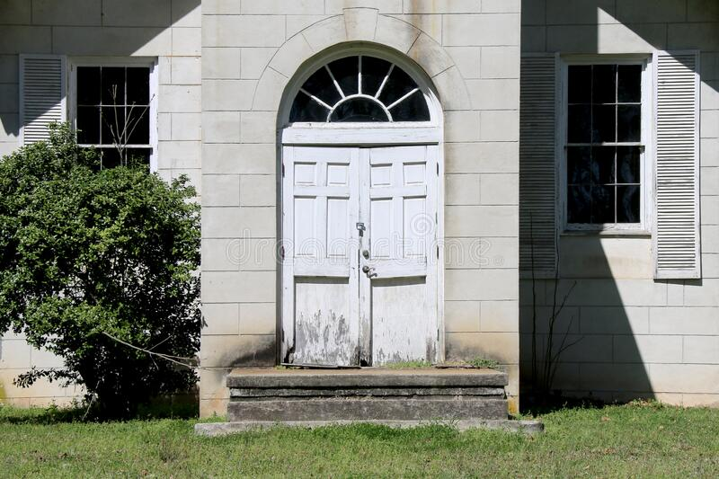 Vintage southern stone abandoned church doors stock image