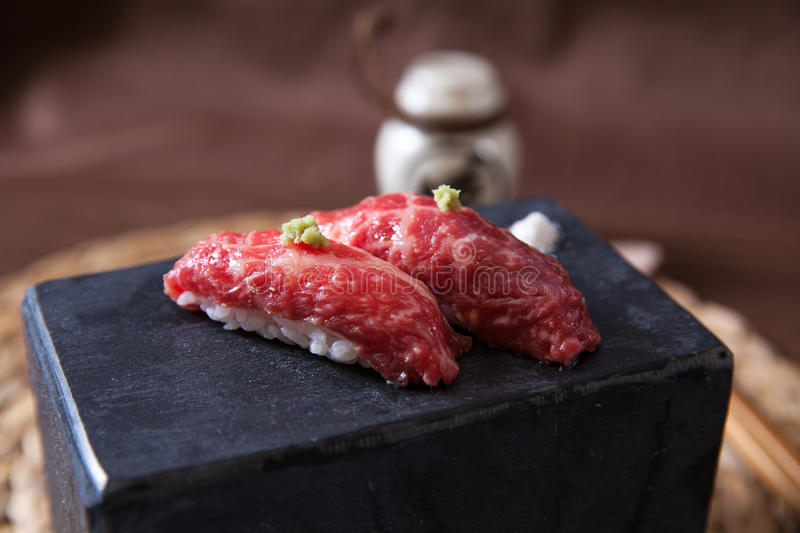 Pair of Wagyu Beef Sushi. Pair of japanese Wagyu Beef sushi on a white background royalty free stock photography