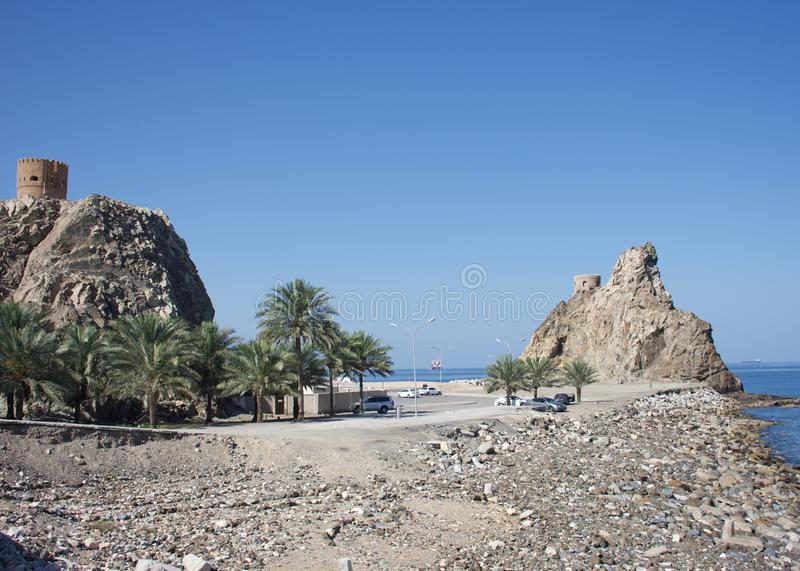 A pair of watchtowers along the Muscat, Oman coast. stock image
