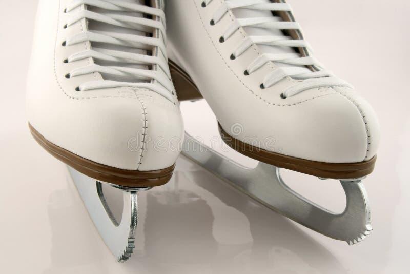 A pair of white figure skates. A pair of elegant white figure skates royalty free stock photos