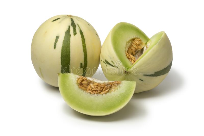Pair of white honeydew melons. And a wedge isolated on white background royalty free stock image