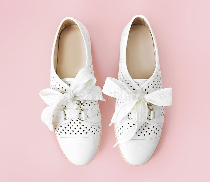 Pair white leather female sneackers with shoe lace,pair woman`s shoes stock image