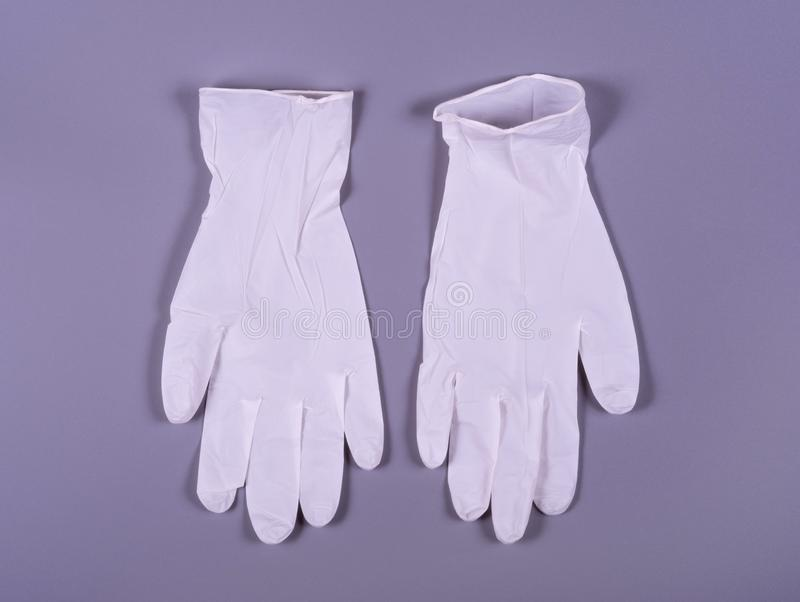 A pair of white medical gloves royalty free stock images