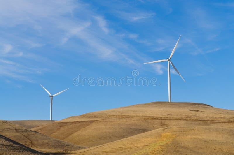 Pair of wind powered generators stock photo