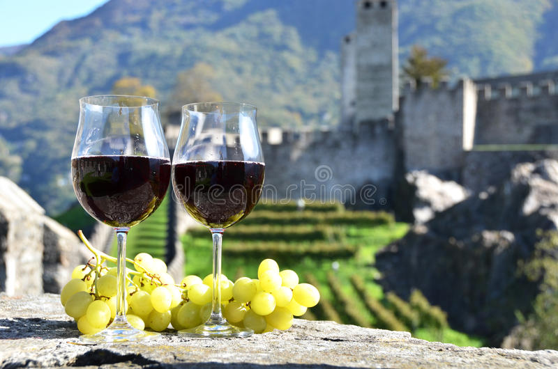 Pair of wineglasses and grapes. Bellinzona, Switzerland royalty free stock images