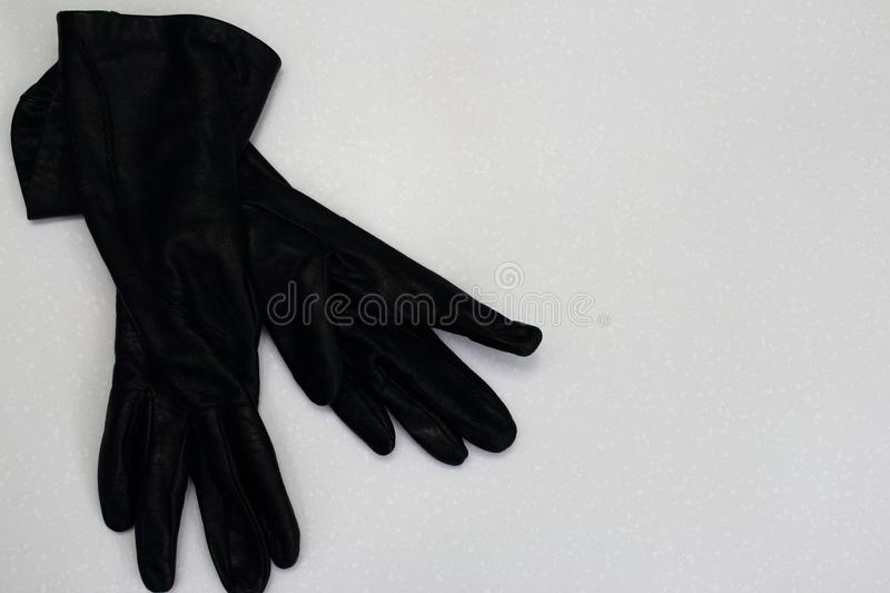 Pair of women black leather gloves isolated on white background as women elegant autumn winter fashion. stock photo