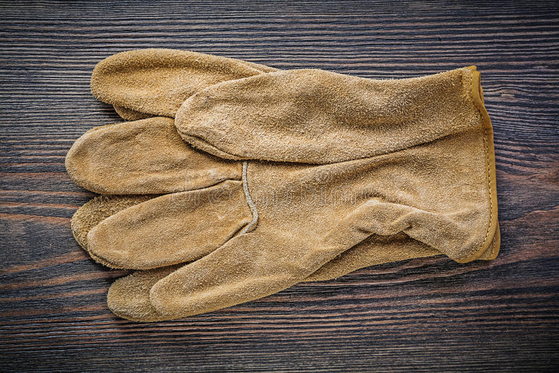 Pair of working gloves on vintage wooden board directly above ag. Riculture concept stock photography