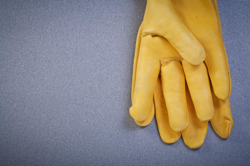 Pair of working safety gloves on grey background construction co. Ncept royalty free stock image