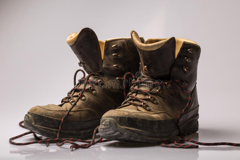 Pair of worn brown leather hiking boots stock photos