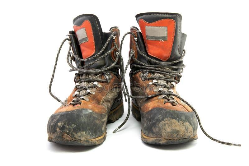 A pair worn hiking boots stock photos