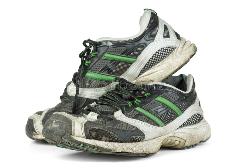 Pair of worn sneakers stock photography