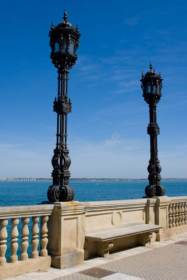 Pair of Wrought Iron lights agaist blue sky