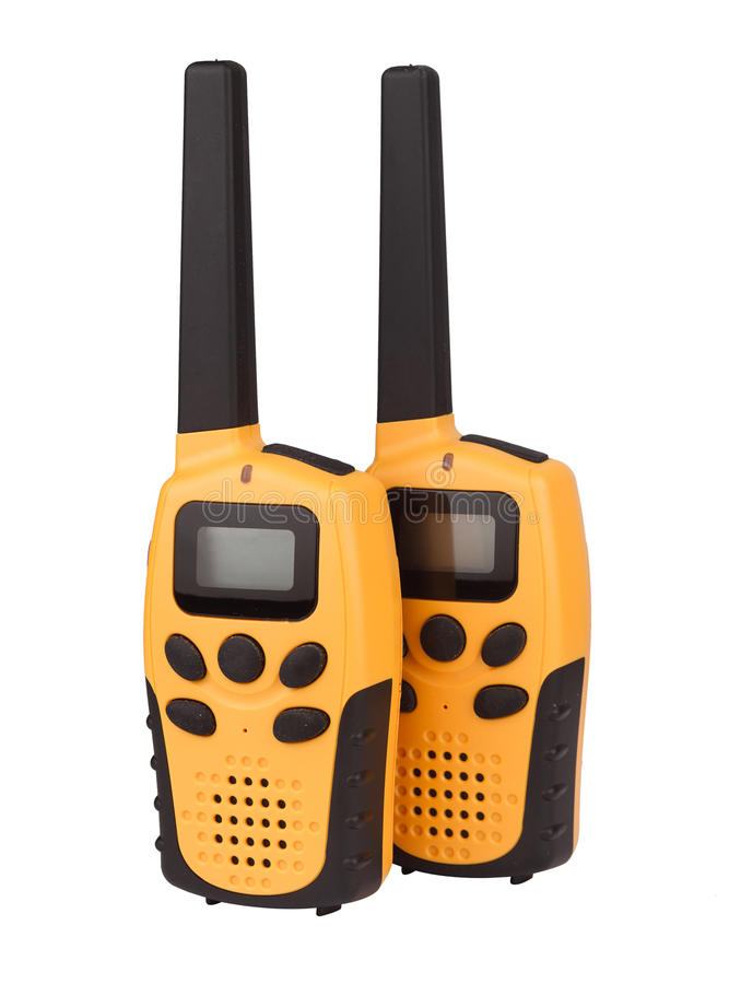 Pair of yellow walkie talkie isolated. Front view of a pair of yellow walkie talkie with black keypad isolated on white background royalty free stock photo