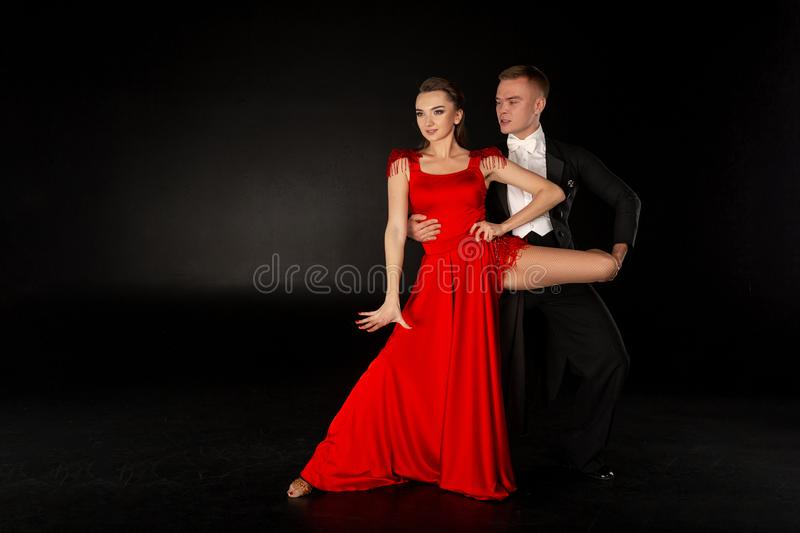 Pair of young dancers posing in dance pose royalty free stock photography