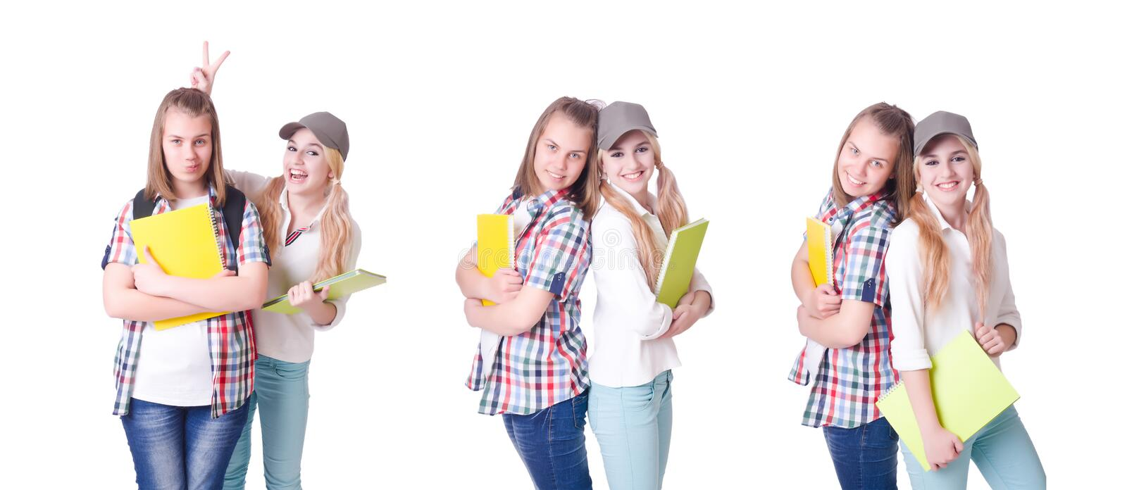 The pair of young students on white stock image