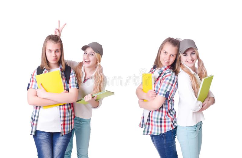 Pair of young students on white stock images