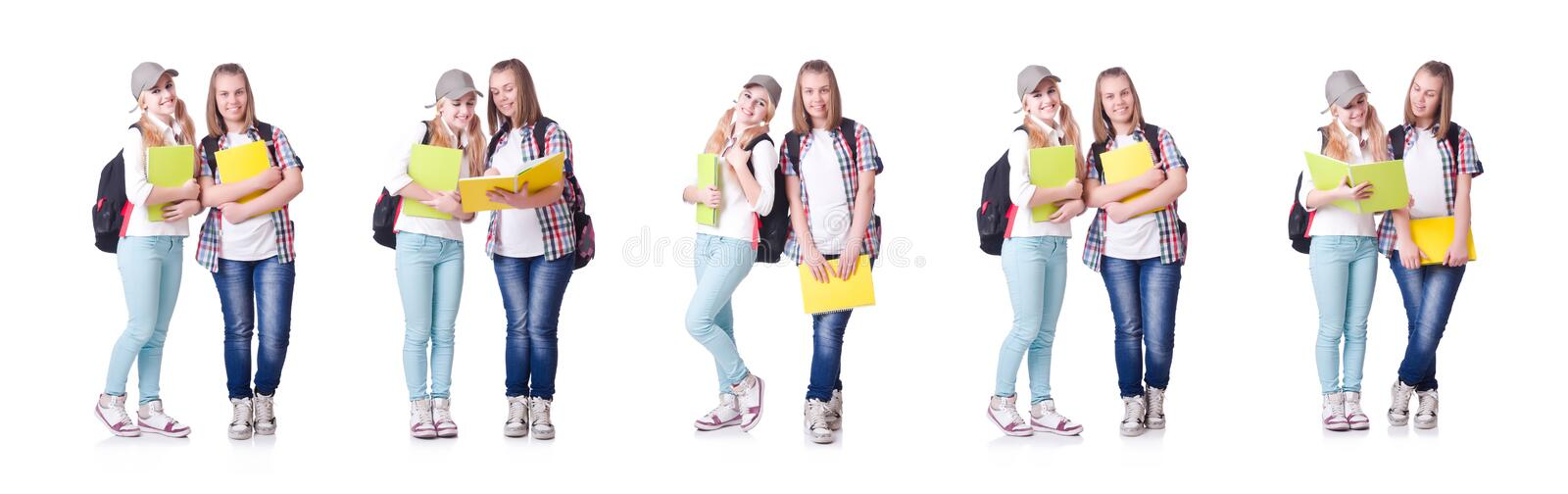 Pair of young students on white stock image