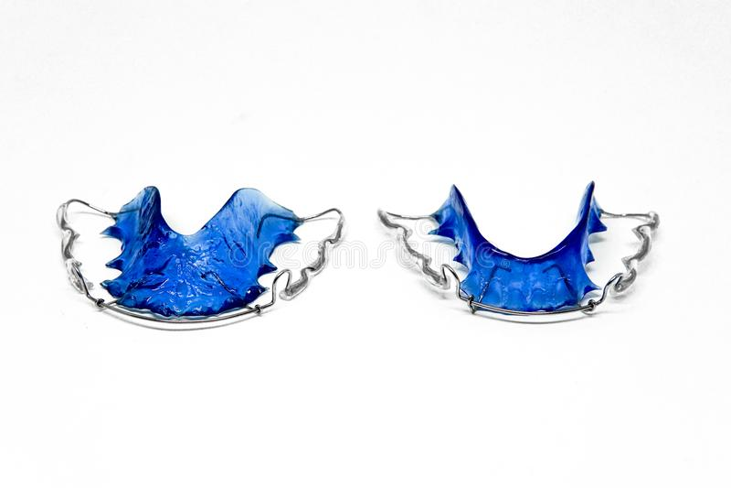 Paires d'arrêtoirs dentaires bleus d'isolement photographie stock libre de droits