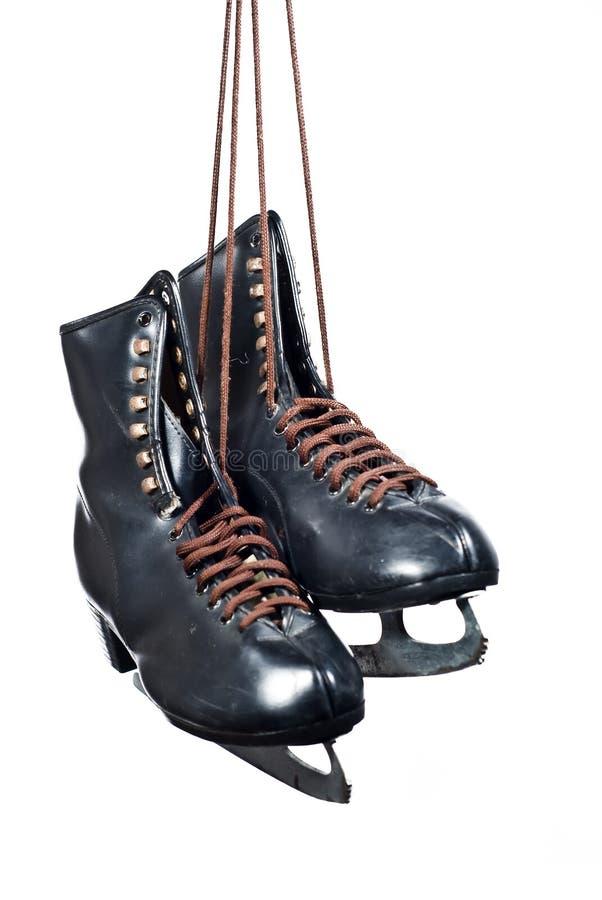 Paires de figure noire s'arrêter de patins photographie stock
