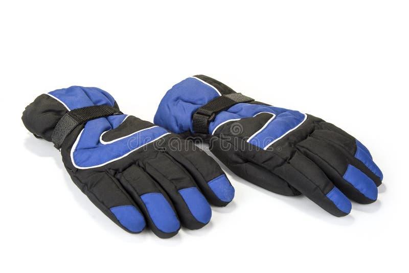 Paires de gants chauds d'hiver sur le blanc images libres de droits
