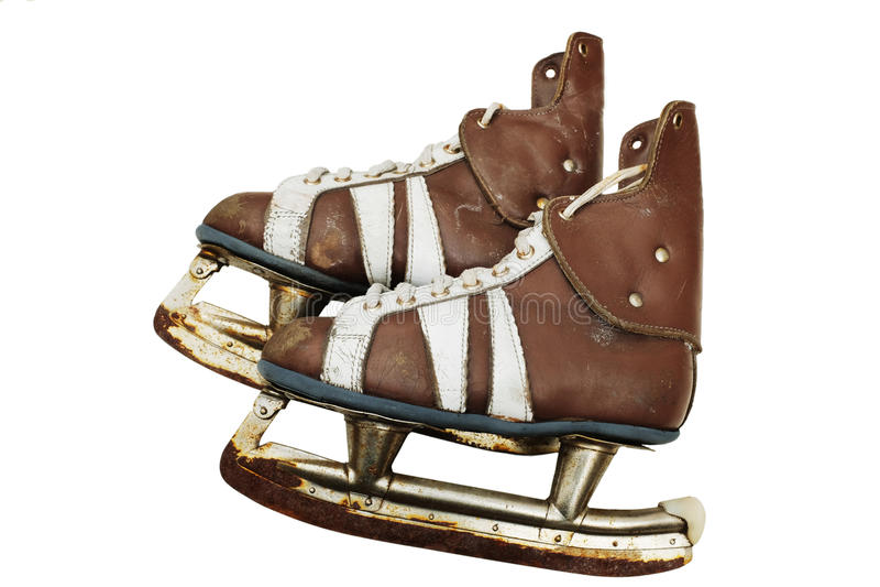 Paires de vintage de patins de glace des hommes sur le blanc image libre de droits