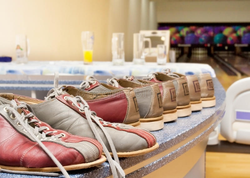 Pairs of bowling shoes stock photos