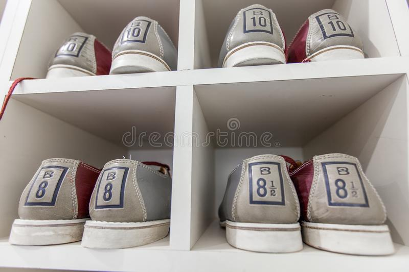 Bowling shoes on the shelf stock image
