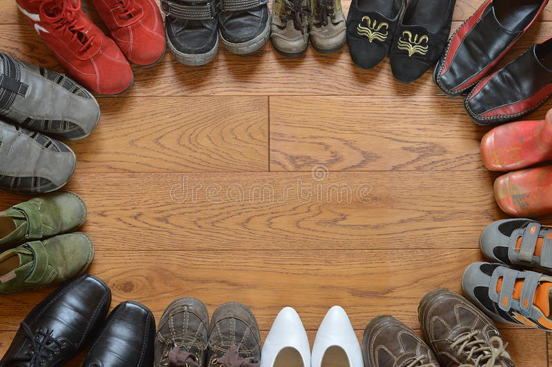 Pairs of different shoes standing in a circle. Many pairs of different shoes standing in a circle stock images