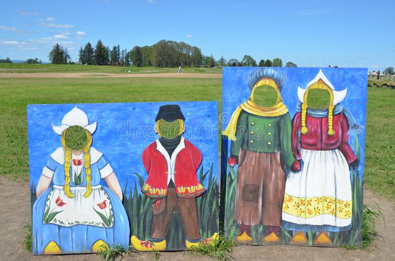 Dutch Characters at Wooden Shoe Tulip Farm. These are pairs of Dutch children and adult character photographic sets at Wooden Shoe Tulip Farm near Woodburn stock image