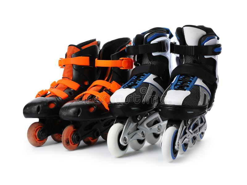 Pairs of inline roller skates. On white background stock photography
