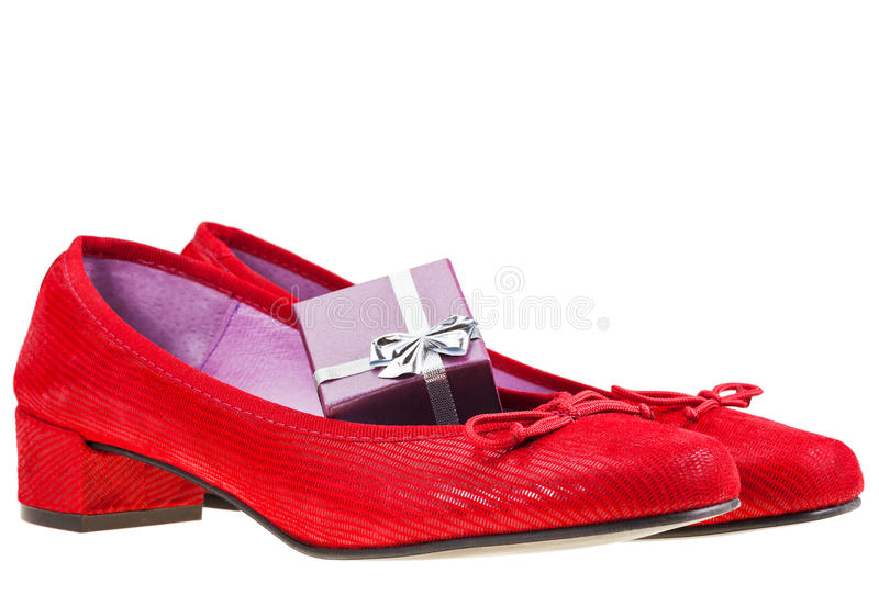 Red women's shoes with gift box stock photos