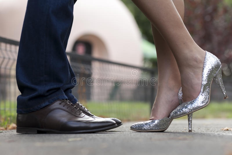 Pairs of shoes of a couple in love. Two pairs of shoes from a couple in love stock photo