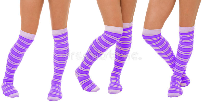 Pairs of women legs in purple socks. Standing in different poses isolated on white stock photos