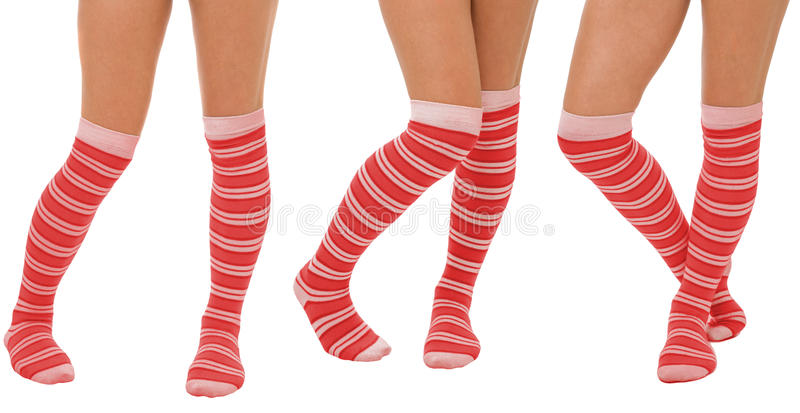 Pairs of women legs in red socks. Pairs of women legs in color red socks standing in different poses isolated on white stock photography