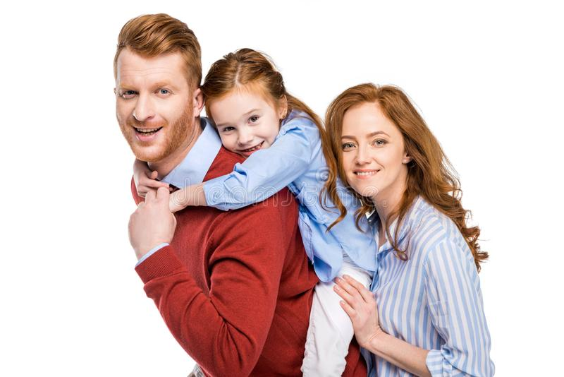 pais felizes com a filha pequena bonito que sorri na câmera imagens de stock royalty free