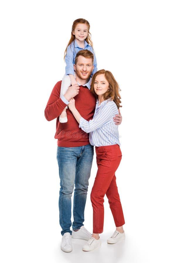 pais felizes com a filha pequena bonito que sorri na câmera fotos de stock