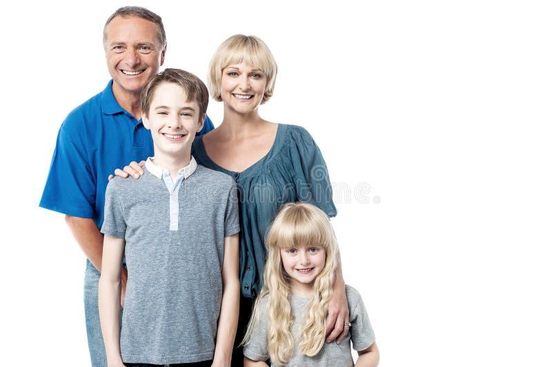 Pais felizes com suas crianças fotos de stock royalty free