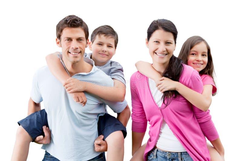 Pais felizes que rebocam crianças imagens de stock royalty free