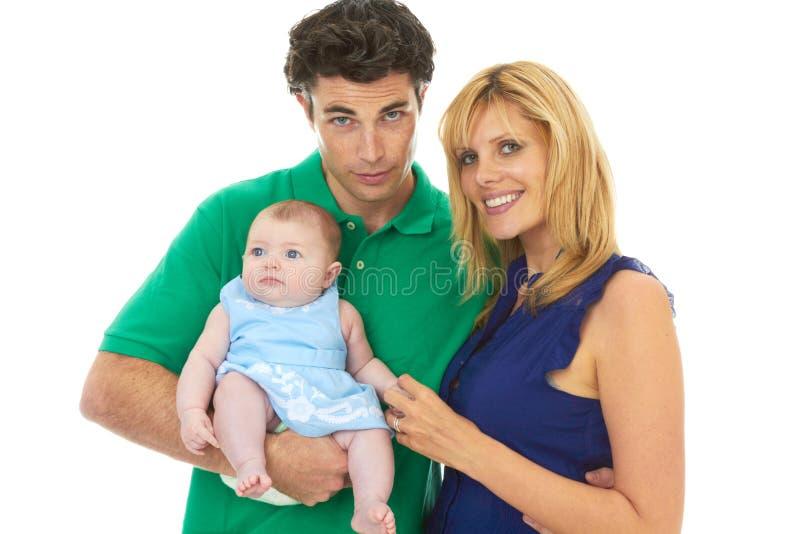 Pais novos orgulhosos com bebê fotografia de stock