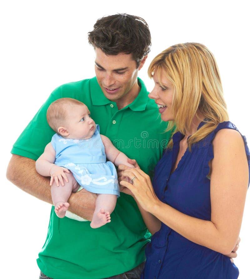 Pais novos orgulhosos com bebê fotos de stock royalty free