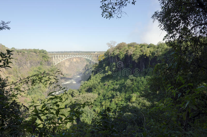 Paisagem larga do fundo da vista da ponte de Victoria Falls a Zimbabwe, Livingstone, Zâmbia fotografia de stock