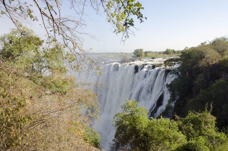 Paisaje amplio del fondo de la visión de Victoria Falls, Livingstone, Zambia foto de archivo libre de regalías