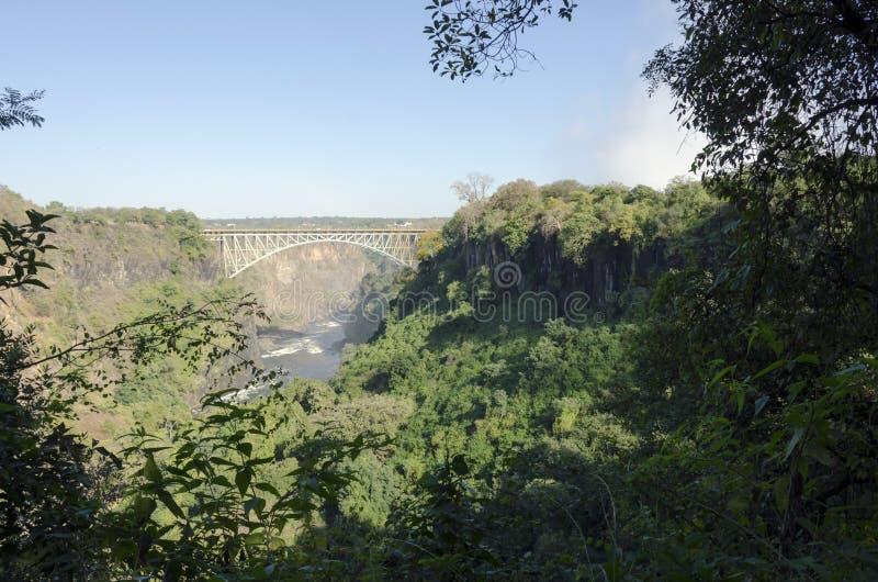 Paisaje amplio del fondo de la visión del puente de Victoria Falls a Zimbabwe, Livingstone, Zambia fotografía de archivo