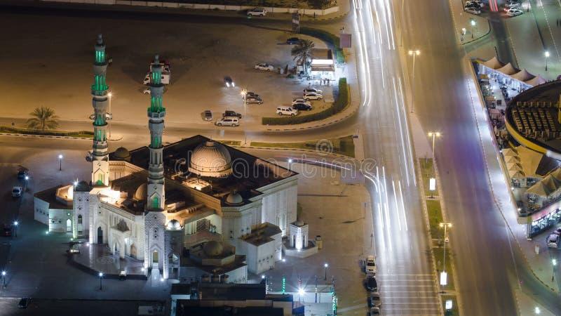 Paisaje urbano de Ajman del tejado después del timelapse de la puesta del sol Ajman es el capital del emirato de Ajman en los Uni fotografía de archivo libre de regalías