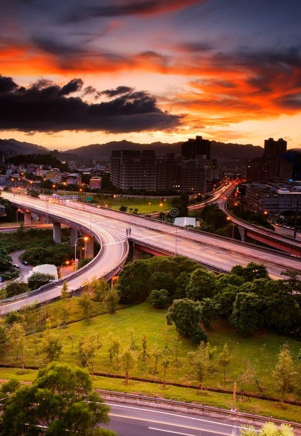 Paisaje urbano de la puesta del sol imágenes de archivo libres de regalías
