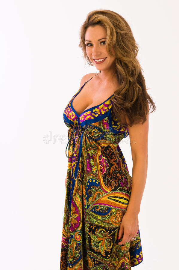 Paisley dress. Beautiful young brown haired girl in a long paisley dress stock image