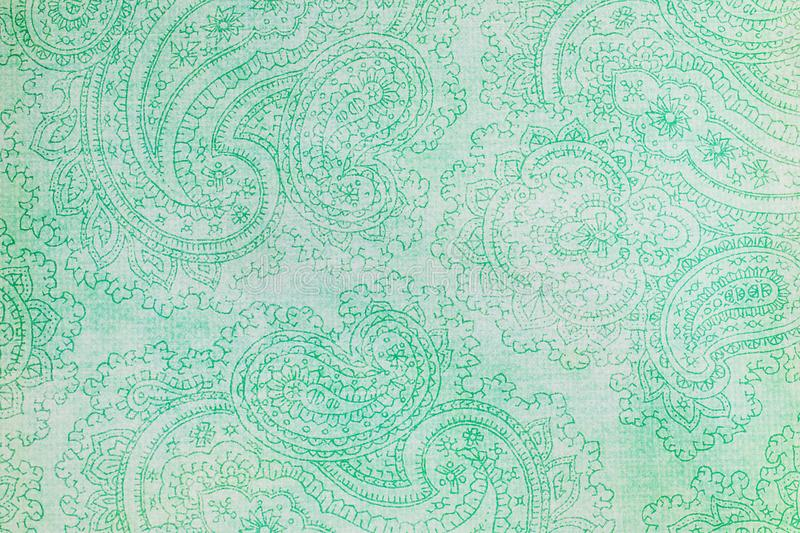 Paisley patterned background in shades of green. royalty free illustration