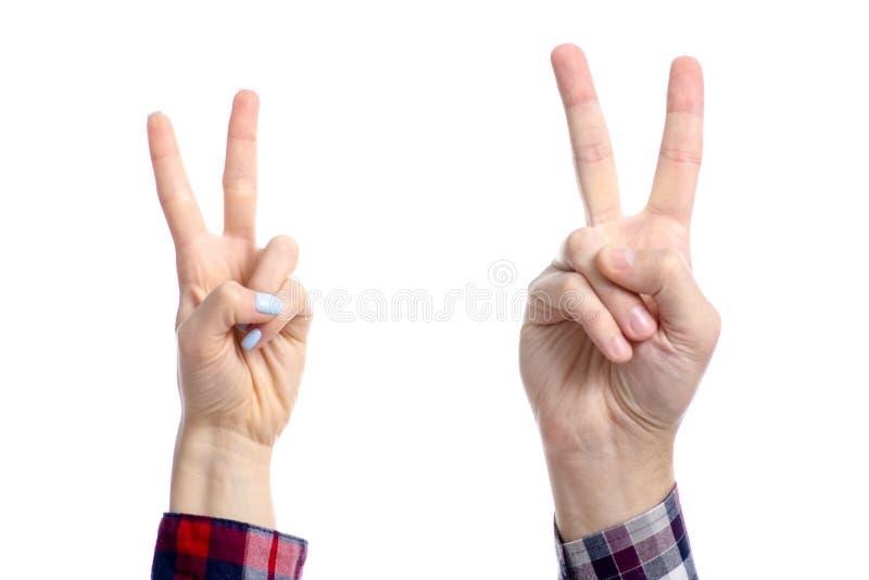 Paix de deux de mains de femme d'homme doigts de l'apparence deux photo libre de droits