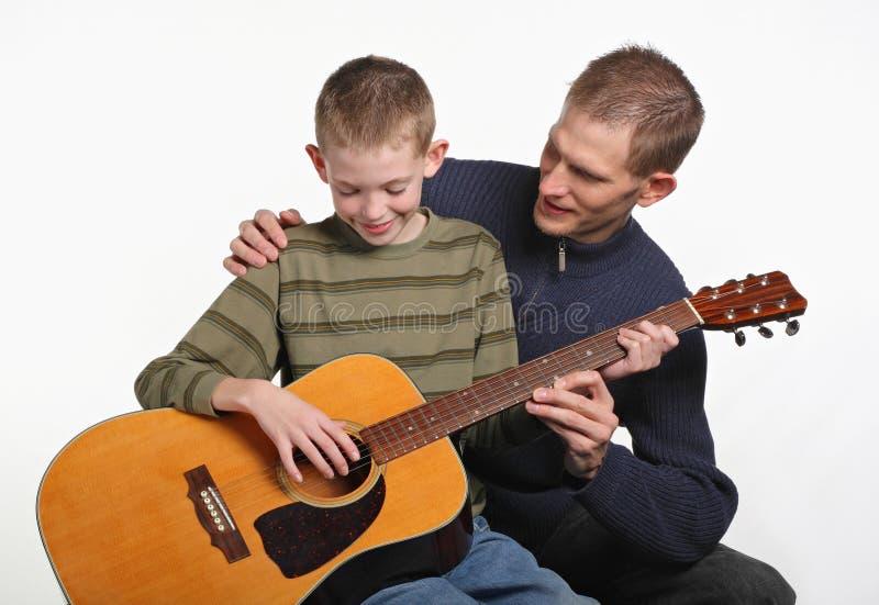 Paizinho da guitarra fotos de stock