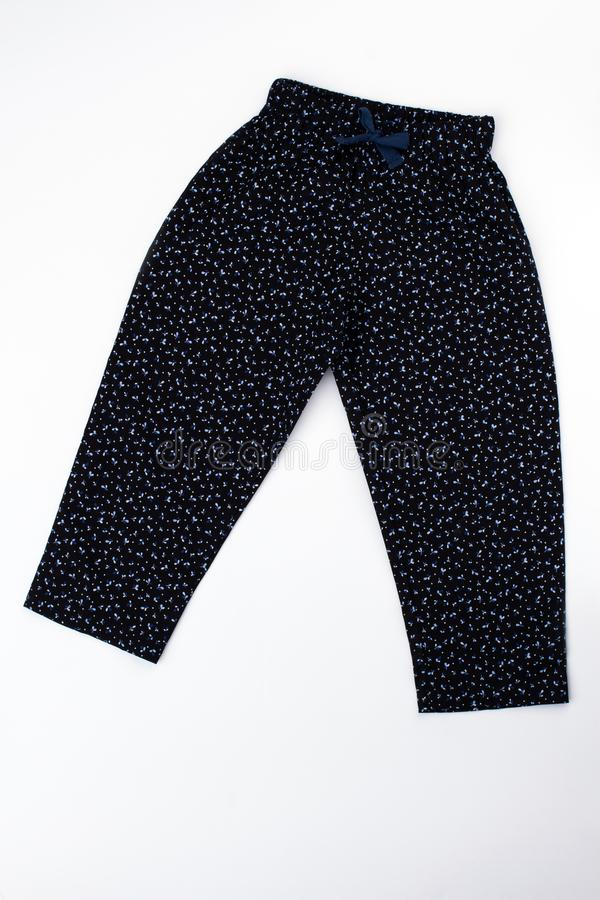 Pajama pants for young girl. Black bottom garment with fine pattern. Loose fitting and with drawstring on waist stock images